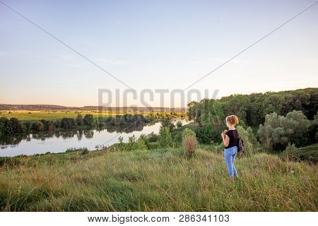 The Young Girl Contemplates The Beauty Of Nature. The Girl From The Hill Looks At The River And The