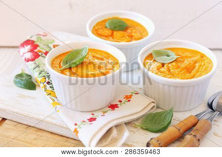 Dietetic Food. Three Servings Of Carrot Flan On Light Background. Focus Selective