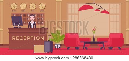 Hotel Receptionist In Lobby At Front Desk. Young Attractive Woman In Reception Area, Greets And Deal