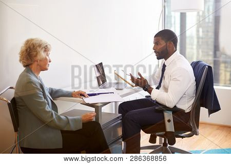 Senior Woman Meetings With Male Doctor Financial Advisor Cosmetic Surgeon In Office