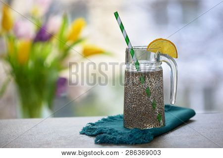 Chia Seeds In Glass Of Water, Close Up