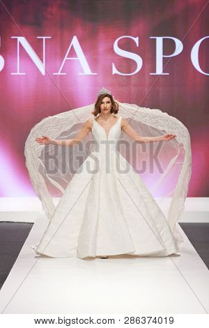 ZAGREB, CROATIA - FEBRUARY 02, 2019: Fashion model in a wedding dressby Vesna Sposa  walking down the runway at the Wedding fair