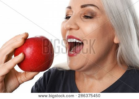 Smiling Woman With Perfect Teeth And Red Apple On White Background, Closeup