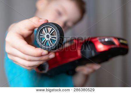boy broke the toy. broken wheel from the car poster