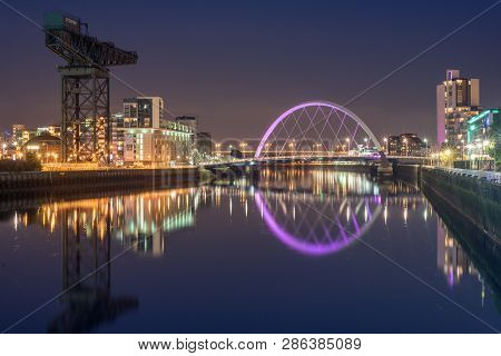 Glasgow/scotland - September 20 2016: The Clyde Arc And Surrounding Buildings Reflected In The Clyde