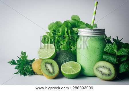 Green Detox Healthy Smoothie From Green Fruit - Avocado, Salad, Kale, Lime, Kiwi, Mint. Alkaline Die