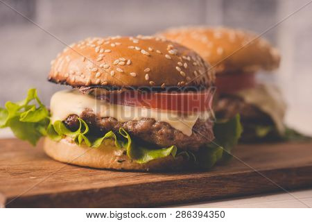 Hamburger Or Sandwich On Brown Paper. Delicious Sandwich Hamburger With Meat, Cheese And Fresh Veget