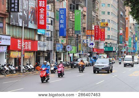 Keelung, Taiwan - November 23, 2018: People Ride Scooters In Keelung, Taiwan. Keelung Is The 9th Mos