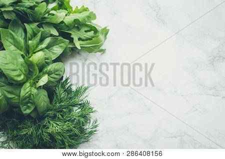 Freshly Harvested Herbs, Bunches Of Fresh Herb On White Marble Background From Above. Bundles Of Org
