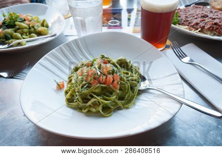 Linguini Pasta With Tomatoes Served On White Plate. Food Background