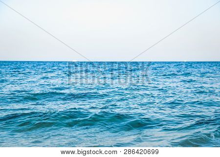 Beautiful Serene Clear Turquoise Sea Ocean Water Surface With Ripples And Low Waves On Seascape Back