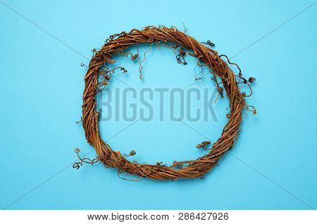 Grape Vine Wreath Isolated On A Blue Background. Top View.