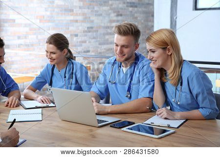 Medical Students In Uniforms Studying At University