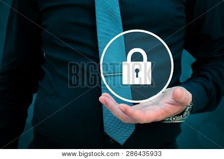 Security Concept, Businessman Holding Lock In His Hand