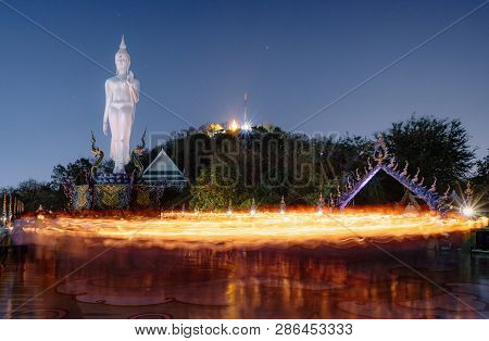 The Candle Lit Ceremony Around The Buddha Image, Makha Bucha Day.