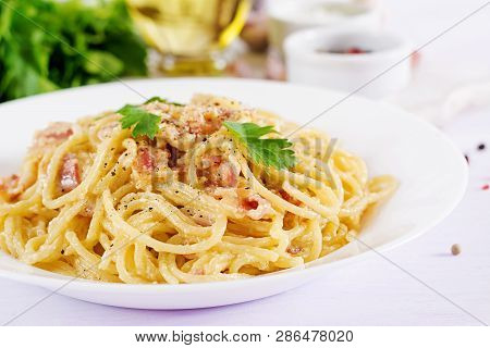 Classic Homemade Carbonara Pasta With Pancetta, Egg, Hard Parmesan Cheese And Cream Sauce. Italian C