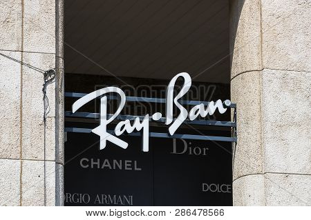 Milan, Italy - 2 June, 2018: Logo Of The Ray-ban Store On The Street Of Milan In Italy.