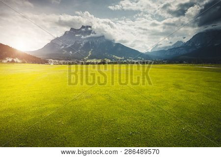 Splendid green golf course in Lermoos village. Location place Austrian Alps, Tyrol, Reutte district, Austria, Europe. Scenic image of most popular vacation destinations. Discover the beauty of earth.