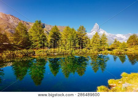 Breathtaking view of Matterhorn spire. Location place Grindjisee lake, Cervino peak, Swiss valley, Switzerland, Europe. Scenic image of most popular tourist attraction. Discover the beauty of earth.