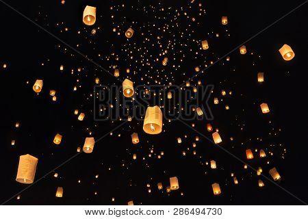 Floating Lanterns In The Night Sky. Launching Sky Lantern. Yee Peng Festival, Loy Krathong Celebrati