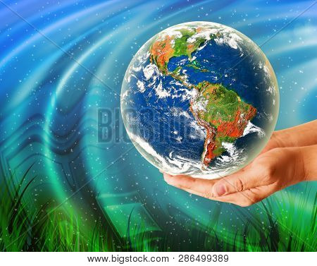 Ecological concept of the environment with the cultivation of trees on the ground in the hands. Planet Earth. Physical globe of the earth. Elements of this image furnished by NASA. 3D illustration