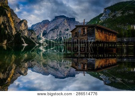 Majestic water reflection of Lago Braies, , Dolomites mountain lake in sunrise light scenery in Eastern Dolomites, Italy Europe. Stunning mountain nature scenery  travel destination.
