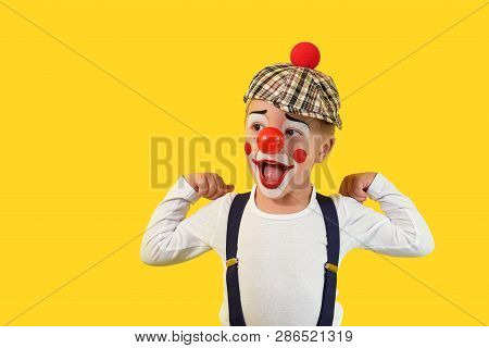 Portrait Funny Child.cheerful Boy, Costume Clown, Red Nose, Makeup.emotional Face Little Comic Kid.h