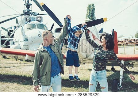 Born To Be Adventurers. Family On Vacation Trip. Couple With Boy Child At Helicopter. Helicopter Tou