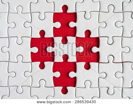 Three White Jigsaw Puzzle On Red Background In Top View (business Concept)