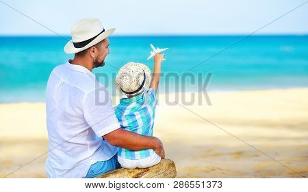 Happy Father's Day! Dad And Child Son On Beach By Sea With Model Toy Plane     .