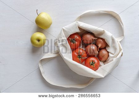 Assorted Fresh Produce In A Re-sable Cloth Shopping Bag Viewed Top Down With Apples, Tomatoes And On