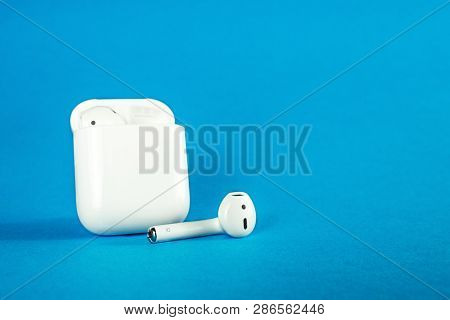 Rostov-on-don, Russia - February 24, 2019: Apple Airpods Wireless Bluetooth Headphones And Charging