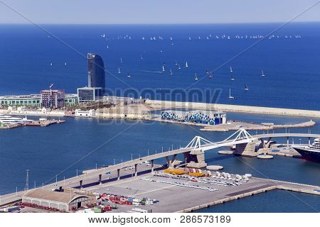 Spain, Barcelona, June, 27, 2015 - Port Vell Against The Background Of A Sailing Regatta In The Medi