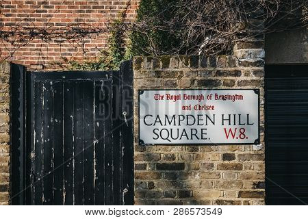 London, Uk - February 23, 2019: Campden Hill Square Street Name Sign On A Brick Wall In The Royal Bo