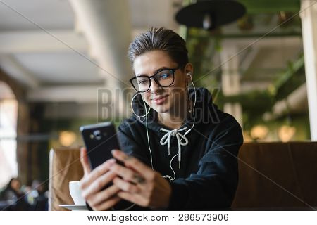 Shortcut Hipster Young Woman Searching Music On Internet Websites For Uploading In Playlist On Mobil
