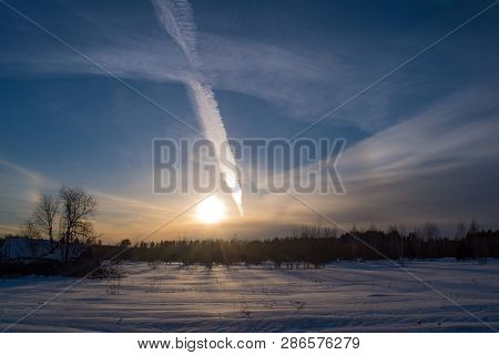 Beautiful Winter Sunset With A Cloudy Sky In February Evening.