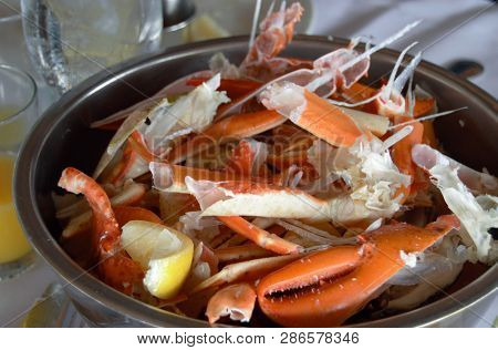Cracked Crab Legs And Claws In Bucket