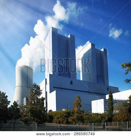 Power Engineering And Electric Power Generation Concept. Cooling Tower And Modern Thermal Power Stat