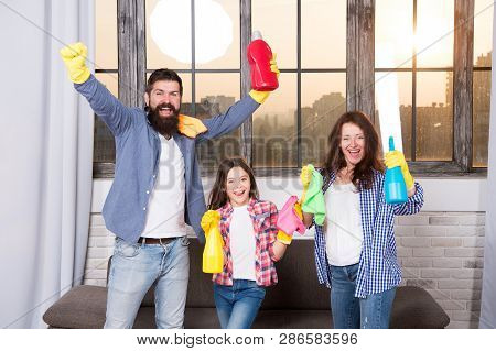Spring Cleaning. Your One Stop For Home Cleaning Needs. Happy Family Hold Cleaning Products. Mother,