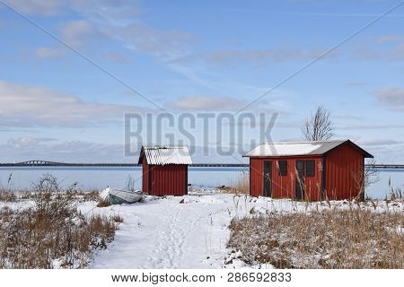 Beautiful Old Fishing Cabins By Farjestaden At The Swedish Island Oland With The Oland Bridge In The