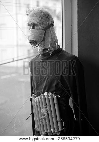 Stop terror. Terrorist bomber in gas mask dummy casualty in head. Terrorist wear fake suicide bombers belt. Suicide attacker. War soldier or victim. War or terrorism attack. Countering terrorism. poster
