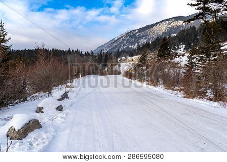 Snow And Ice Covered Road In Banff National Park During Winter. This Is Vermillion Lakes Road