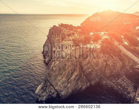 Swallow Nest, Ancient Castle On Top Of Mountain Cliff Near Sea Yalta Region At Sunset, Crimea. Beaut
