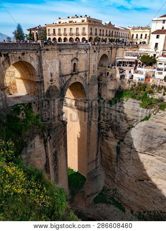 Ronda, Spain, Februaryl 23, 2019: Tourists visit new bridge in Village of Ronda in Andalusia, Spain