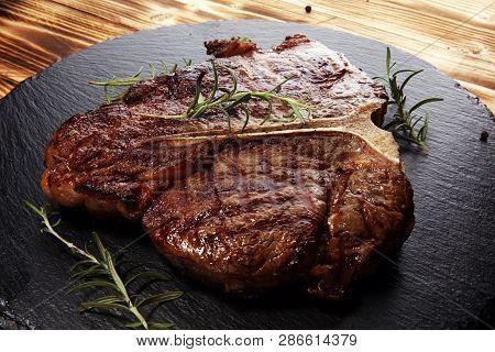 Grilled T-bone Steak On Stone Cutting Board.