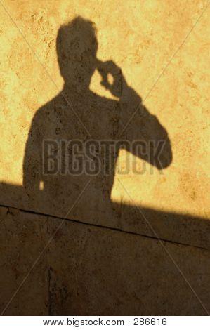 Man Shadow On Phone