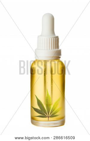 Concept For Medicinal Oil Made From Cannabis Using A Dropper Bottle Filled With A Golden Oil And A C
