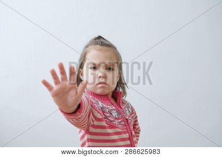 Stop Sign, Toddlers Palm Saying Stop With Hands In Front Of Himself. Suspend Of Constraint On Childr