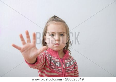 Stop Sign, Little Girls Palm Saying Stop With Hands In Front Of Himself. Suspend Of Constraint On Ch
