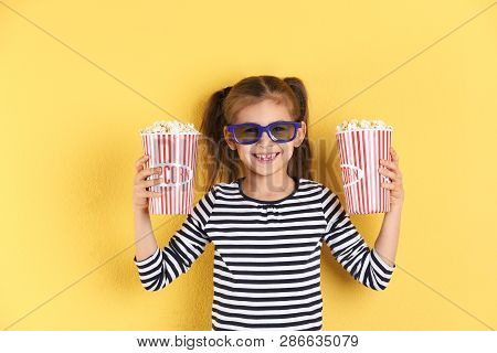 Cute Little Girl With Popcorn And Glasses On Color Background